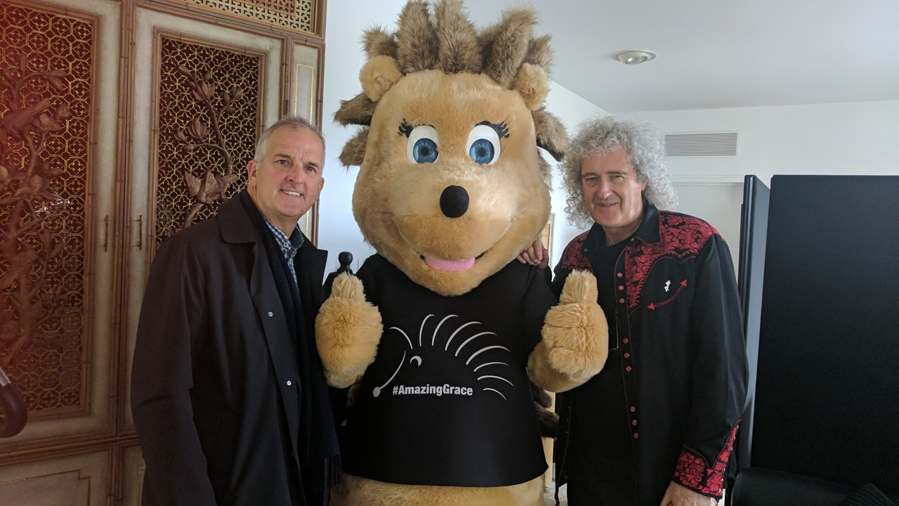 Cllr Robert Evans with Brian May and hedgehog