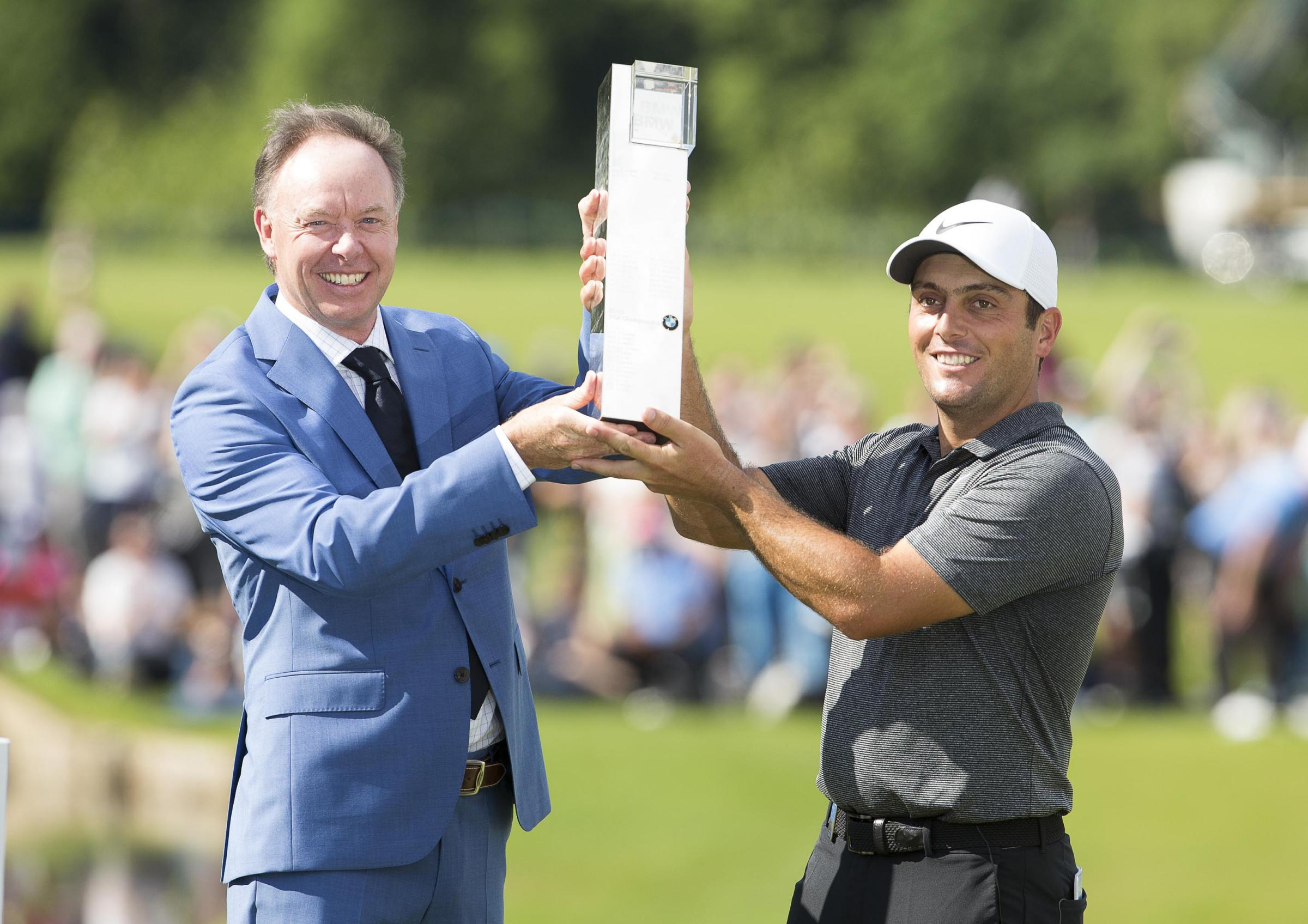 Francesco Molinari receives the trophy  Pictures by Paul Terry